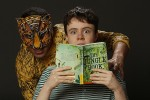 photo - Luc Roderique as Shere Khan and Camille Legg as Mowgli in Carousel Theatre for Young People's The Jungle Book