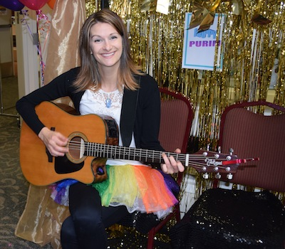 photo - Music therapist Megan Goudreau provides holiday entertainment