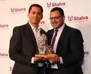 photo  - Shai Gross, left, receives the Shalva Spirit of Hope Award from Avi Samuels, deputy director of Shalva