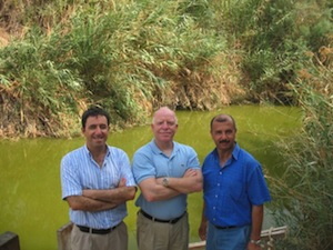 photo - The three co-directors of EcoPeace Middle East at the Jordan River. From left to right: Gidon Bromberg (Israel), Munqeth Mehyar (Jordan) and Nader Khateeb (Palestine)