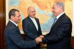 photo - Nadav Argaman, left, is congratulated by Prime Minister Binyamin Netanyahu at the Prime Minister's Office on May 8, as he takes over as head of Israel's Shin Bet security service. In the centre is outgoing head Yoram Cohen, who had led the security service since 2011. Argaman became deputy head of the service in 2011. Prior to that, he was the chief of operations from 2003 to 2007 and, from 2007 to 2011, he was Shin Bet's representative in the United States