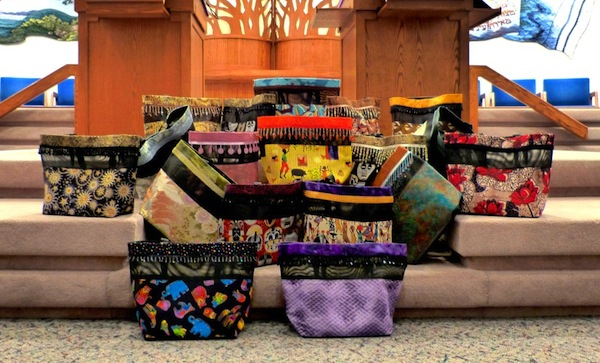 photo - Totes made by Tikun Olam Gogos, and other Gogos, will be on sale at the Voices for Africa fundraiser on June 15