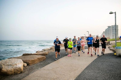 photo - Premier of the Province of Ontario, Kathleen Wynne, even went jogging early and well-covered promenade of Tel Aviv