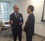 photo - Jonathan Kallner, event speaker and managing partner, KPMG, talks with Eli Joseph, senior account manager, business and personal, RBC Royal Bank, at Schara Tzedeck's LinkYid networking event June 3