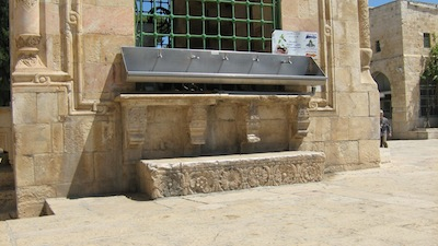 photo - The Mamluks' Sabil Qaitbay (Fountain of Qayt Bay), located on the Temple Mount, was built in the 15th century. Note the contrast between the modern metal trough and the ornate Crusader stone door fixture used as a step