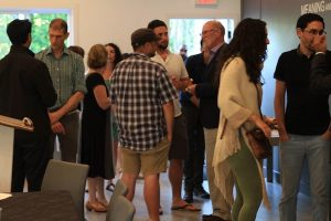 photo in Jewish Independent - Panelists Tom Davidoff, second from the left, and Michael Geller, third from the right, mingle with the crowd at the Community Kollel on June 28