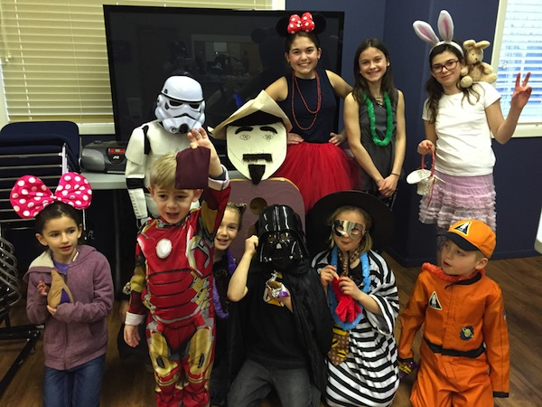 photo in Jewish Independent - Dressed for Purim, left to right: in the front row, Bria Tizel, Anderson Parnes, Kate Spevakow, Ryder Golbey, Skyla Golbey and Chase Golbey; in the back, Jordan Spevakow, Abbey Parnes and a friend, and Adarah Challmie