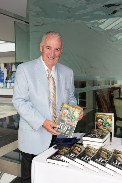 photo - Dr. Peter Legge and his wife, Kay, provided a copy to every family in attendance of his book Lunch with Joe