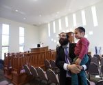 photo - Rabbi Meir Kaplan and his 3-year-old son Sholom Ber Kaplan check out the new Chabad Centre for Jewish Life and Learning on Glasgow Street, near Topaz Park, in Victoria on Aug. 24