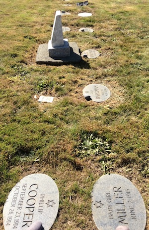 photo - Headstones for the graves of 87 babies and children were unveiled at Mountain View Cemetery's Jewish section on Sept. 11