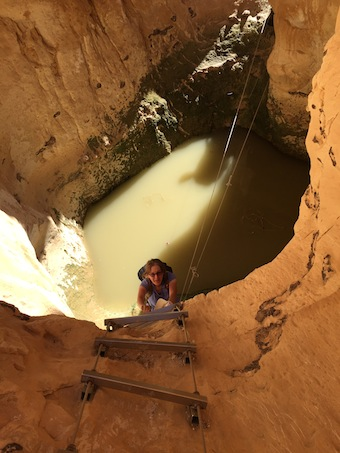 photo - Jennifer Williamson climbs up a ladder after she and hiking partner Arlene Doyle had to trek through a pool of water