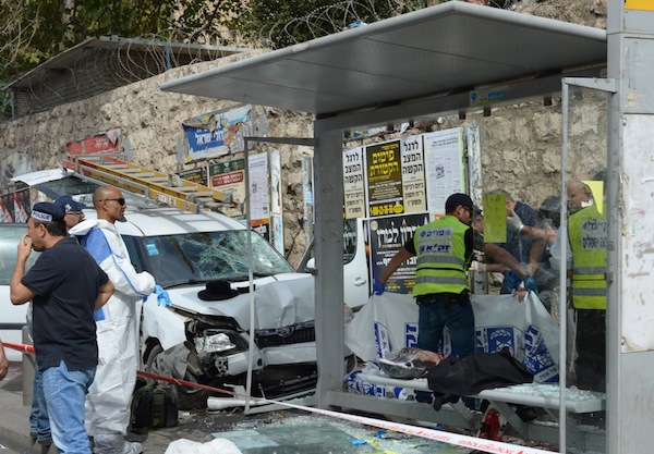 photo - A bus stop in Jerusalem's Malkei Yisrael Street after a terrorist drove his car into the stop, killing one man, and then got out of his vehicle to stab others at random