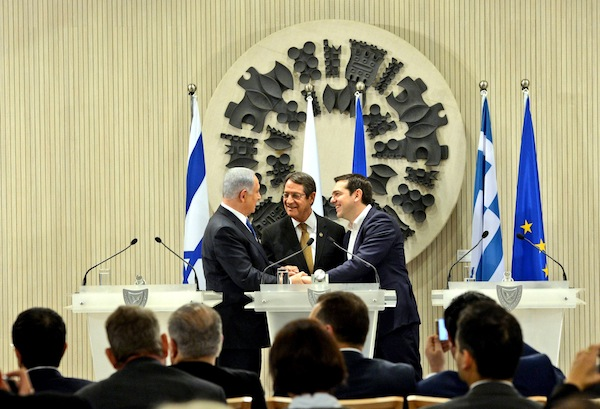 photo - Prime Minister Binyamin Netanyahu, left, Cypriot President Nicos Anastasiades, centre, and Greek Prime Minister Alexis Tsipras at a meeting in Nicosia to cement trilateral relations