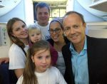 photo - The Hon. Stockwell Day, right, and International Fellowship of Christians and Jews of Canada senior vice-president Rabbi Yael Eckstein with a Ukrainian Jewish family who were among the 220 that the Fellowship brought to Israel on Sept. 29