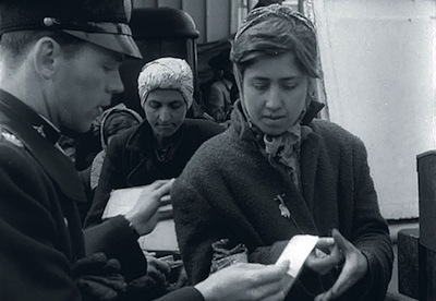 photo - Hinda Jakubowicz stepping off the ferry in Malmö on April 28, 1945