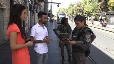 photo - A scene from My Home, in which Muhamed Kabiya undergoes an ID check in Jerusalem