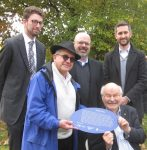 photo - Left to right: Michael Schwartz of the Jewish Museum and Archives of British Columbia, Rabbi Philip Bregman, Rabbi Dan Moskovitz, Mike Harcourt and Chris Gorczynski