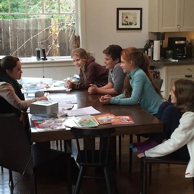 photo - Teacher Corin Neuman with students Maya, Sahra, Sarra and Ocean