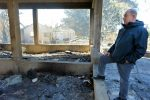 photo - Prime Minister Binyamin Netanyahu examines arson damage in Beit Meir