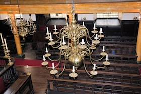 photo - The central candelabrum, one of seven that hang in Bevis Marks, was a gift from the community of Amsterdam at the time of its original construction
