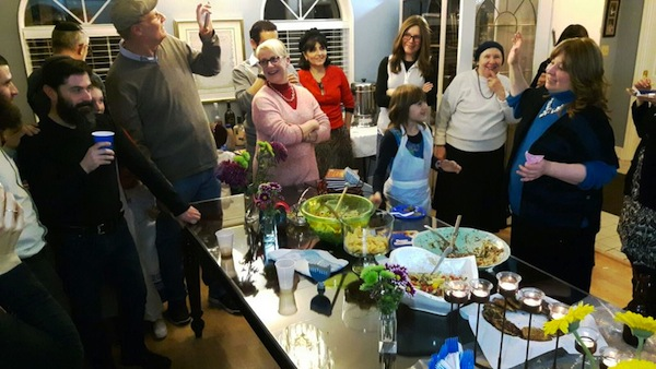 "photo - ""Young and old joined together for an evening of lights, song, great food and amazing fun"" at the Centre for Judaism's Iron Chef Chanukah"