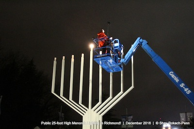 photo - Michael Sachs, president of the Bayit, lights the menorah outside of Richmond Public Library and Cultural Centre on Dec. 26
