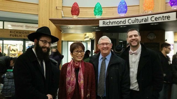 photo - Community leaders at the Dec. 26 menorah lighting in Richmond included, left to right, Bayit Rabbi Levi Varnai, MLA Teresa Wat, councilor Bill McNulty and Bayit president Michael Sachs