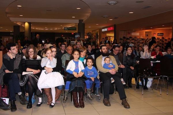 photo - Semiahmoo Shopping Centre was filled on Dec. 29 for the menorah lighting, which was done by Cantor Yaakov Orzech, and the awarding of the 2016 Lamplighter Award to Jason Aginsky (below), among other festive activities