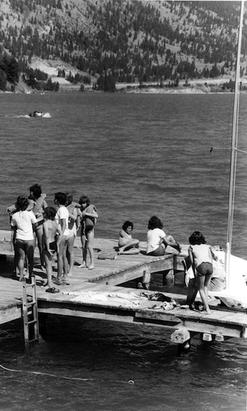 photo - Children on the dock at Camp Hatikvah, 1976. Though the writer's camp experience occurred on a different continent and in a different generation, Jewish overnight camp changed her life