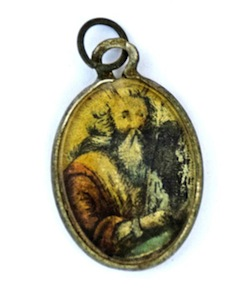 photo - A metal locket covered by glass with the image of Moses holding the Ten Commandments painted on it. (photos from IAA via Ashernet)