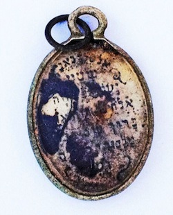 photo - The locket's opposite side has the Shema printed on it
