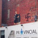 photo - Corey Fleischer volunteers most of his time to removing hateful graffiti