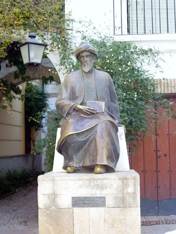 photo - Amadeo Ruiz Olmos' statue of Maimonides stands in the Jewish Quarter of Córdoba, Spain. Maimonides compared tzedakah to a ladder with eight rungs, each of which you climb bringing you closer to heaven