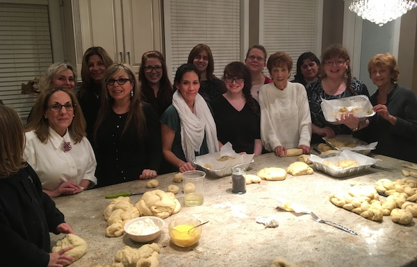 photo - Fifteen Richmond women attended the challah bake hosted by Chanie Baitelman of Chabad of Richmond at her home on Jan. 18, where they learned how to knead, braid and bake challah