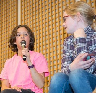 photo - Young audience members hoped to take what they learned at the forum about the immigrant experience and share it with those who could not attend the event