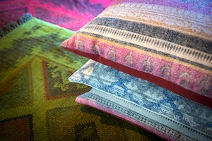photo - Among the offerings at Olive+Wild are textiles
