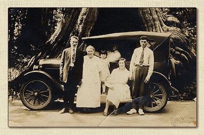 photo - Abraham Nemetz, Toba Nemetz, Esther Wosk, Bill Nemetz (driving), Chava Wosk holding baby Sonny, and Abrasha Wosk; taken at the hollow tree in Stanley Park, 1927