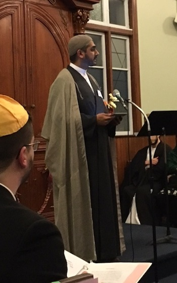 photo - Sheikh Murtaza Bachoo speaks about compassion at the March 9 gathering of faith leaders at Or Shalom
