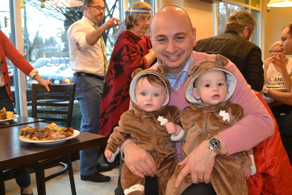 photo - Jewish Federation of Greater Vancouver chief executive officer Ezra Shanken with his nine-month-old twin boys at Café 41 for Purim