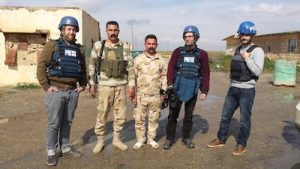 photo - Jesse Rosenfeld with peshmerga combatants, Santiago Bertolino and Ayar Mohammed Rasool