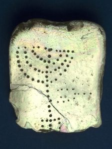 photo - A mother-of-pearl tablet engraved with a seven-branched candelabrum