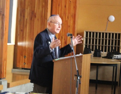 photo - Holocaust survivor Robbie Waisman addresses the assembly for Yom Hashoah at King David High School on April 24