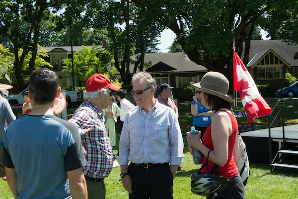 photo - George Heyman, MLA for Vancouver-Fairview, was also at hand at the Douglas Park party. He is seen here speaking with David Berson, left, and Mary Gillis