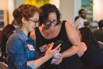 photo - Kara Mintzberg, left, and Dana Troster at the Community Hackathon