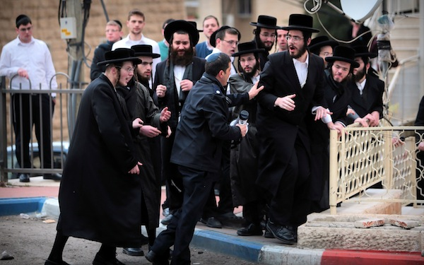 photo - February 2017. Some ultra-Orthodox riot over government insistence that all able-bodied young men be drafted into the army. While heads of many Charedi yeshivot have encouraged their students not to report to induction centres, there are many Israel Defence Force units that have ultra-Orthodox soldiers in their ranks