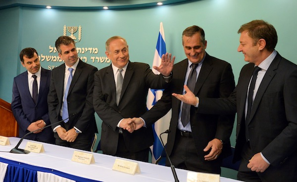 photo - March 2017. Mobileye is bought by Intel, but the headquarters of the company will remain in Jerusalem. Left to right are Amnon Shashua, Eli Cohen, Prime Minister Binyamin Netanyahu, Brian Krzanich and Ziv Aviram