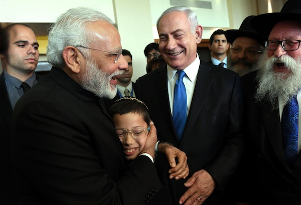 photo - July 2017. Indian Prime Minister Narendra Modi, left, becomes the first sitting Indian prime minister to officially visit Israel. Accompanied by Prime Minister Binyamin Netanyahu, Modi meets with Moshe Holtzberg, 10, who survived the terrorist attack that killed Moshe's parents and seven others at Mumbai's Chabad House in November 2008