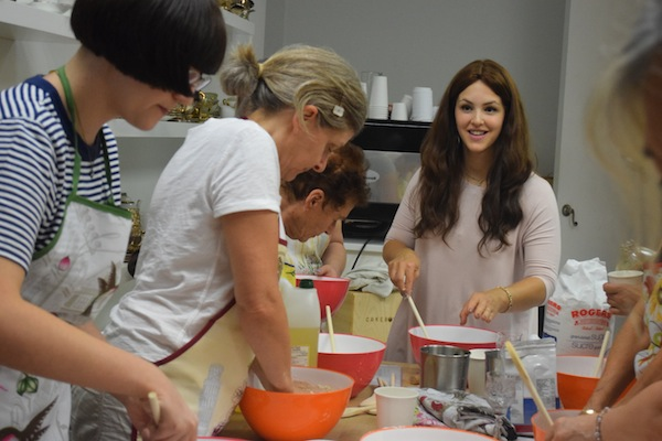 photo - Miki Mochkin teaches a class on baking challah