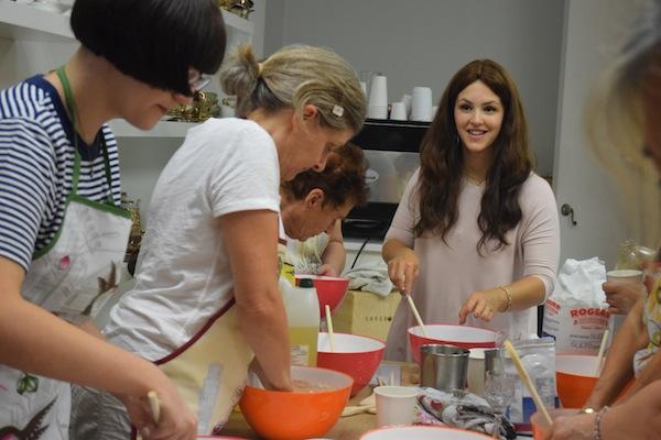 photo - Miki Mochkin teaches a class on baking challah