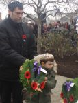photo - White Rock/South Surrey Jewish Community Centre Religious School kindergarten student Navi lays the WRSS JCC wreath at the cenotaph on Remembrance Day